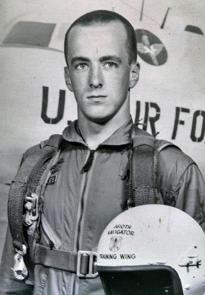 Lt. Col. Barry Cupples poses with an aircraft and helmet. Cupples is the father of current 328th Airlift Squadron Navigator, Lt. Col. Barry Cupples, Jr. The father and son flew together on the C-130 Hercules aircraft at Niagara Falls Air Reserve Station.