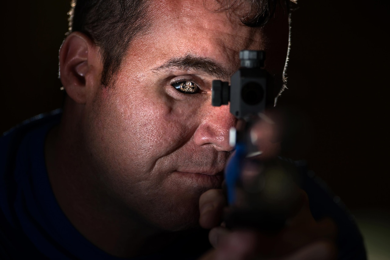 Air Force veteran Master Sgt. D. Reese Hines poses for a photo with a competition air rifle at the U.S. Military Academy in West Point, N.Y., June 19, 2016. Hines was named the event's Ultimate Champion after winning a series of events. DoD photo by EJ Hersom
