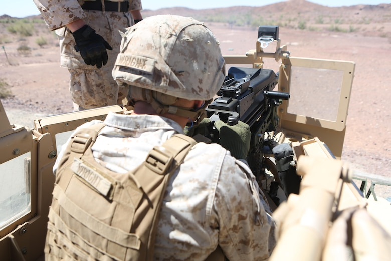 Cpl. Dakota Wright, a motor transport operator with Motor Transport Company, Marine Wing Support Squadron (MWSS) 371, fires an MK-19 grenade launcher mounted on a Humvee at Yuma Proving Grounds, Ariz., June 16. Marines with MWSS-371 conducted crew-served weapons training with MK-19 grenade launchers and M2 .50-caliber machine guns mounted onto 7-ton trucks and Humvees to hone their skills and increase their readiness. (U.S. Marine Corps photo by Sgt. Brytani Wheeler/Released)