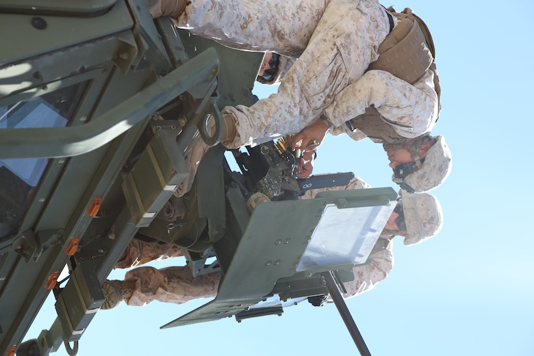 Sgt. Manuel Soto Jr., left, and Sgt. Jonathan Temple, right, motor transport operators with Motor Transport Company, Marine Wing Support Squadron (MWSS) 371, load ammunition into an M2 .50-caliber machine gun at Yuma Proving Grounds, Ariz., June 16. Marines with MWSS-371 conducted crew-served weapons training with MK-19 grenade launchers and M2 .50-caliber machine guns mounted onto 7-ton trucks and Humvees to hone their skills and increase their readiness. (U.S. Marine Corps photo by Sgt. Brytani Wheeler/Released)