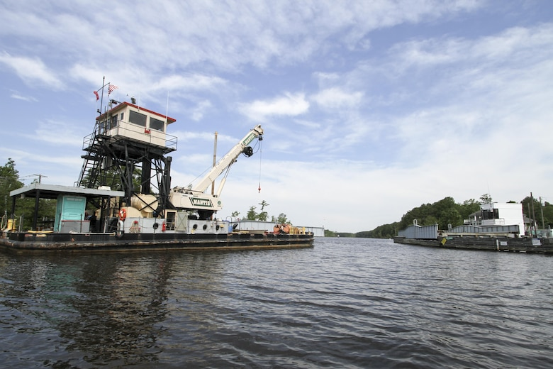 The Norfolk District, U.S. Army Corps of Engineers derrick boat ELIZABETH sits moored at the North Landing Bridge as contractors work to repair the bridge June 21, 2016. The ELIZABETH provided logistical support and manpower to the repair operations, which were needed after gearing was damaged by a barge strike on June 4. (U.S. Army photo/Patrick Bloodgood)