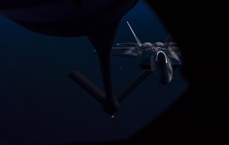 An F-22 Raptor, assigned to the 433rd Weapons Squadron, Nellis Air Force Base, Nev., prepares to be refueled during Deliberate Strike Night over the Nevada Test and Training Range, June 16, 2016. This focus makes DSN a distinctive part of Advanced Integration and the unique training of the select Airmen who earn the coveted Weapons School patch and who ensure the air superiority of the United States Air Force. (U.S. Air Force photo by Airman 1st Class Kevin Tanenbaum)