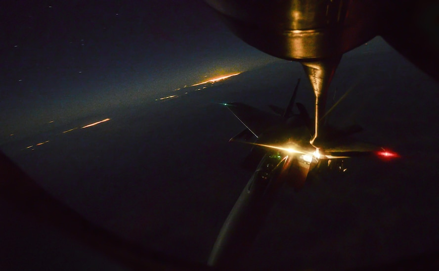 An F-15 Strike Eagle, assigned to the 433rd Weapons Squadron, Nellis Air Force Base, Nev., is refueled in-air during Deliberate Strike Night over the Nevada Test and Training Range, June 16, 2016. With approximately 60 airframes working together serve to accomplish DSN focus of Air Force low-observable and conventional platforms deliberately targeting an adversary's simulated IADS in an antiaccess, area denial scenario. (U.S. Air Force photo by Airman 1st Class Kevin Tanenbaum)