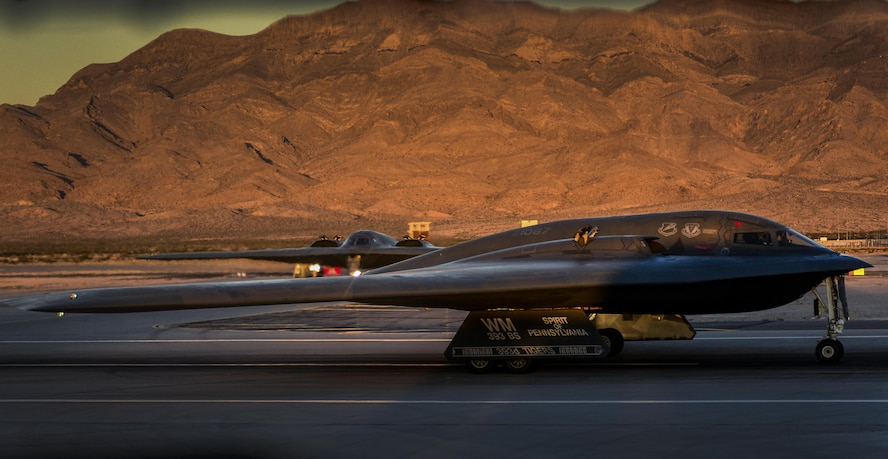 Two B-2 Sprit's, assigned to the 325th Weapons Squadron, Whiteman Air Force Base, Missouri, taxi down the runway as they prepare to takeoff during Deliberate Strike Night at Nellis Air Force Base, Nevada, June 16, 2016. Since the focus of DSN is on 5th Generation Stealth assets with 4th Generation Conventional assets one of the main players during the night is the B-2 Spirit. (U.S. Air Force photo by Airman 1st Class Kevin Tanenbaum)