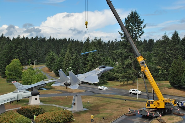 """A large crane carefully hoisted a McDonnel Douglas F-15A Eagle onto its display pedestal at the Western Air Defense Sector (WADS) Air Park June 14.  The unit received approval from the National Museum of the Air Force to acquire the F-15 from the Aerospace Maintenance and Regeneration Group (also known as the """"Boneyard"""") located at Davis-Monthan AFB, Ariz.  The WADS mission is to scramble Air National Guard F-15 and F-16 alert fighters at a moment's notice in order to identify, detect and defend against airborne threats.  There will be a formal dedication ceremony Sept. 13 at the WADS parade grounds.  (U.S. Air National Guard photo by Capt. Kimberly Burke)"""