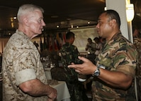 Tongan Maritime Force Lt. Cmdr. Semisi Palu Tapueluelu, talks to U.S. Marine Corps Lt. Gen. John A. Toolan, commander, U.S. Marine Corps Forces, Pacific before day three of U.S. Pacific Command's Amphibious Leaders Symposium (PALS) begins on Marine Corps Base Hawaii, Kaneohe Bay, Hawaii, May 20, 2015. PALS is designed to bring together senior leaders of allied and partner Marine Corps, naval infantries, and militaries spanning the Indo-Asia-Pacific region with interest in military amphibious capability development. This year, 22 nations sent representatives to observe the training. (U.S. Marine Corps photo by Lance Cpl. Wesley Timm/Released)