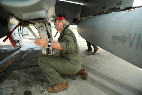 U.S. Marine Corps Sgt. Malcolm Cappelle, a quality assurance safety observer with Marine Fighter Attack Squadron (VMFA) 314, stationed at Marine Corps Air Station Miramar, California, and forward deployed to MCAS Iwakuni, Japan, inspects the undercarriage of an F/A-18C Hornet during exercise Red Flag-Alaska 16-2 at Eielson Air Force Base, Alaska, June 16, 2016. Cappelle is inspecting the jet to make sure everything is secured properly on the squadron's fighter jet so it will be ready for the next mission during its support of exercise Red Flag-Alaska 16-2. (U.S. Marine Corps photo by Lance Cpl. Donato Maffin/Released)