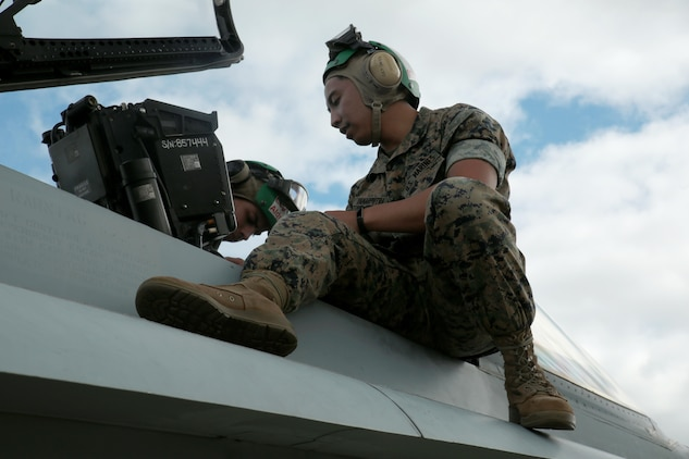 U.S. Marine Corps Cpl. Harley Damarputra, an aviation life-support equipment technician and collateral duty inspector with Marine Fighter Attack Squadron (VMFA) 314, stationed at Marine Corps Air Station Miramar, California, forward deployed to MCAS Iwakuni, Japan, tests a seat in an F/A-18C Hornet during exercise Red Flag-Alaska 16-2 at Eielson Air Force Base, Alaska, June 16, 2016. Damarputra supports the squadron as a life-support equipment technician and collateral duty inspector by ensuring the pilots' safety gear is working properly. (U.S. Marine Corps photo Lance Cpl. Donato Maffin/Released)