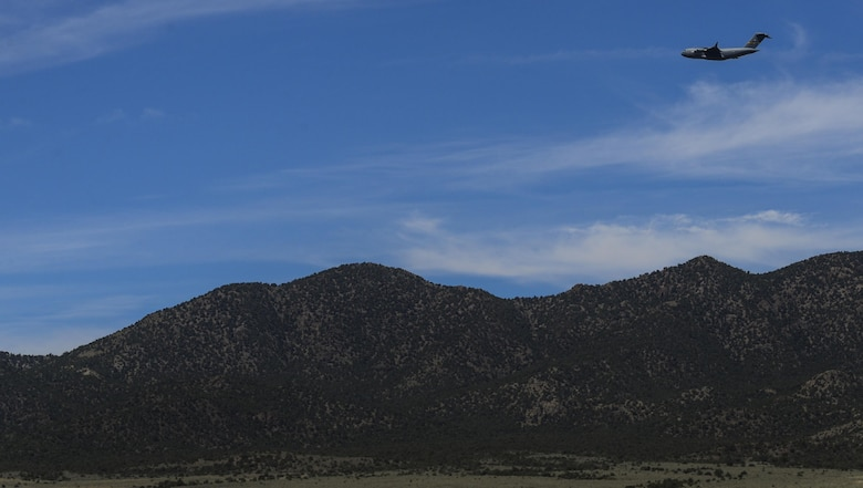 A C-130 Hercules, assigned to the 29th Weapons Squadron, Little Rock Air Force Base, Arkansas, flies over the mountains of the Nevada Test and Training Range during the Joint Forcible Entry Exercise portion of the United States Air Force Weapons School Advanced Integration, June 16, 2016. C-130s are capable of using unprepared runways for takeoffs and landings. (U.S. Air Force photo by Airman 1st Class Kevin Tanenbaum)
