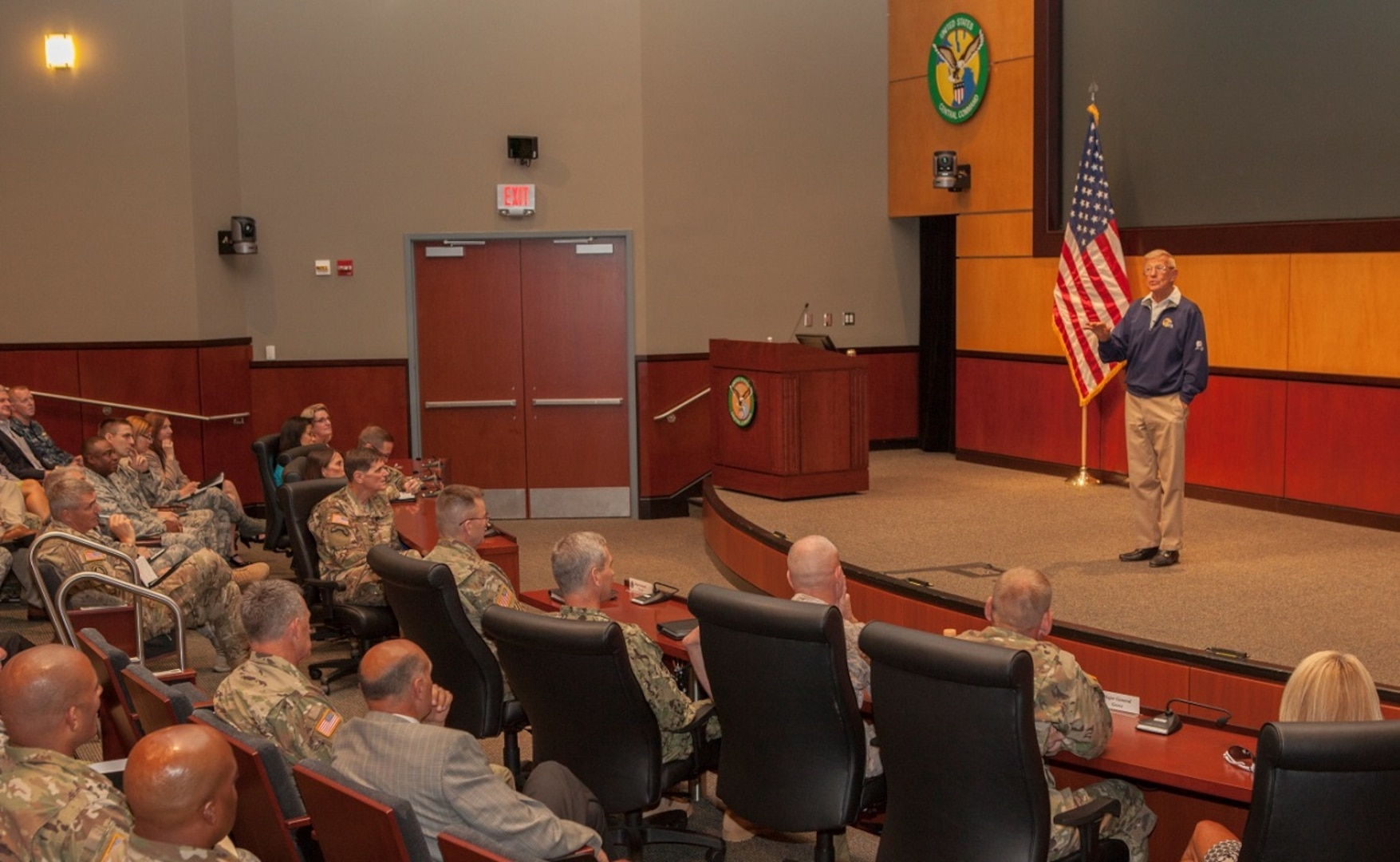 Retired Hall of Fame football coach Lou Holtz gives a motivational speech to service members assigned to U.S. Central Command. Holtz, 79, achieved notoriety for his time coaching at the University of Notre Dame and the University of South Carolina. (CENTCOM photo by Sgt. Jordan Belser)