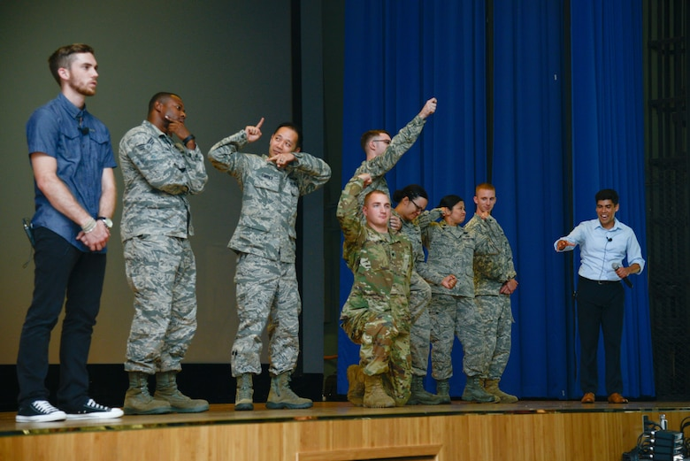 Osan service members join actors onstage during a bystander intervention play at Osan Air Base, Republic of Korea, June 21, 2016. The audience members practiced proactive response to real world situations during the play. (U.S. Air Force photo by Senior Airman Dillian Bamman/Released)