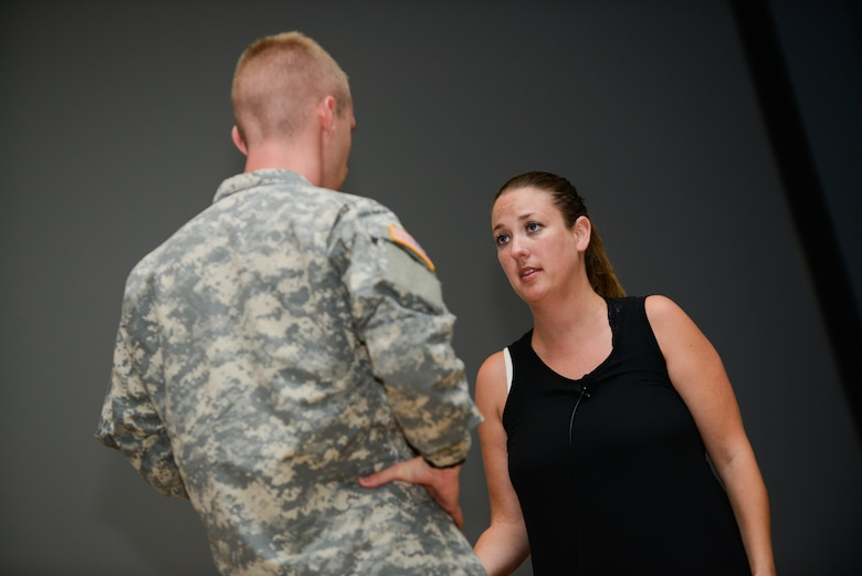 An actor with the Pure Praxis theater group speaks with an Osan soldier during a bystander intervention play at Osan Air Base, Republic of Korea, June 21, 2016. The theater group used improvisational theater to create realistic bystander intervention situations so audience members could rehearse proactive responses.(U.S. Air Force photo by Senior Airman Dillian Bamman/Released)