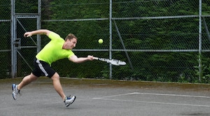 U.S. Air Force Staff Sgt. Brad Coats, 488th Intelligence Squadron mission support supervisor, competes in a singles tennis match during the Marauder Melee event June 16, 2016, on RAF Mildenhall, England. The event was open to all base ID card holders and included various sports such as basketball, table tennis, dodge ball, tennis and more. (U.S. Air Force photo by Airman 1st Class Tenley Long/Released)