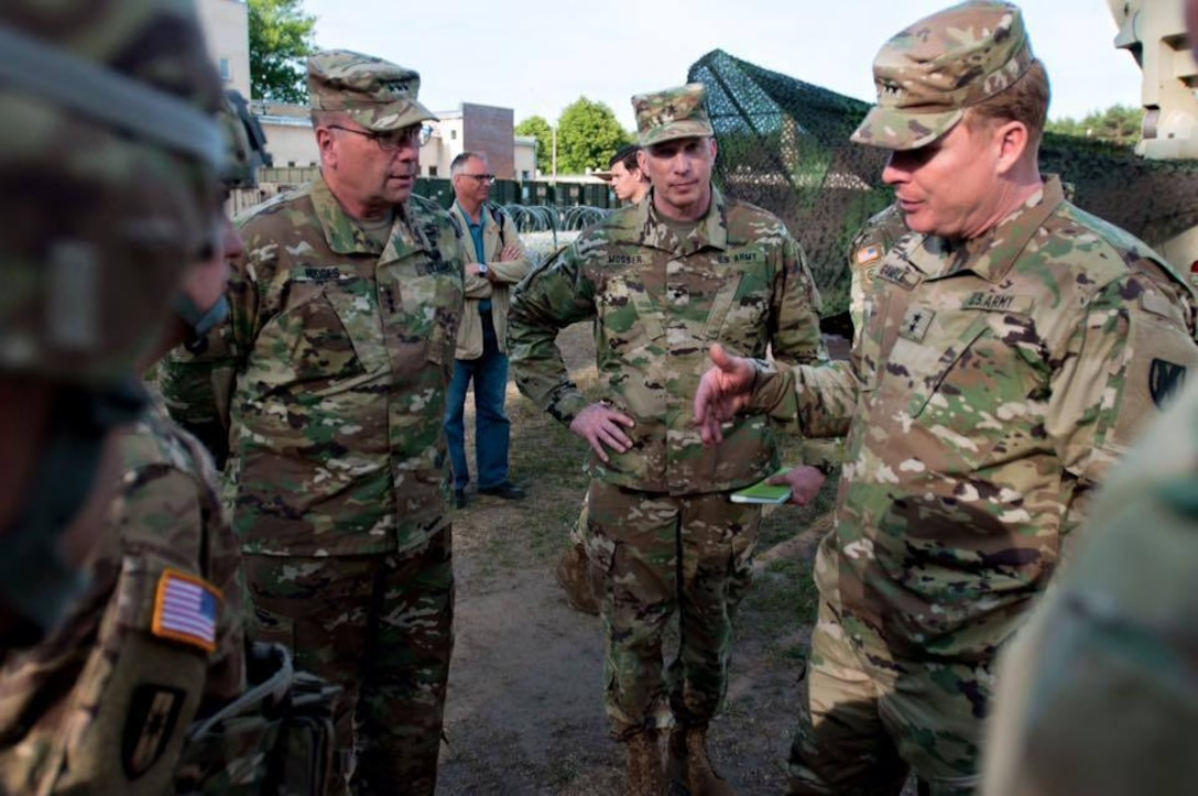 From left to right: Lt. Gen. Ben Hodges, U.S. Army Europe Commanding General, Brig. Gen. Greg Mosser, 364th Expeditionary Sustainment Command Commanding General, and Maj. Gen. Duane Gamble, 21st Theater Sustainment Command Commanding General, are welcomed by Col. William Stubbs, 30th Medical Brigade Commander, to the 30th MB headquarters in Warsaw, Poland on June 9.