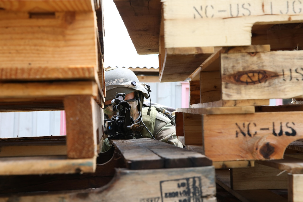 A Dutch soldier assigned to Charlie Company, 11th Infantry Battalion, 11th Airmobile Brigade scans his sector while conducting a town assault scenario during the Swift Response 16 training exercise at the Hohenfels Training Area in Hohenfels, Germany, June 17, 2016. The exercise is one of the premier military crisis response training events in the world for multinational airborne forces. Deputy Defense Secretary Bob Work met with Dutch Defense Minister Secretary-General Wim Geerts at the Pentagon June 21, where the two leaders discussed mutual security issues. Army photo by Staff Sgt. Nathaniel Allen