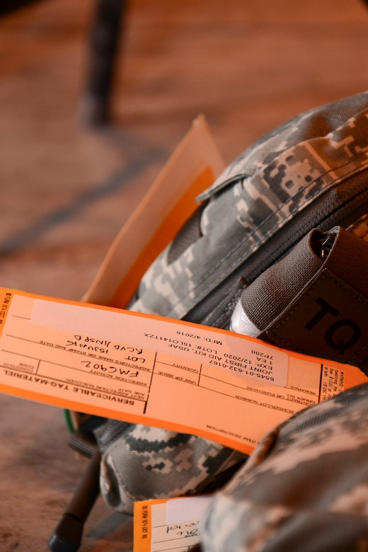 An inspection card is placed on a joint first aid kit (JFAK) at Al Udeid Air Base, Qatar, June 15, 2016. The JFAK is scheduled to replace the formally-used individual first aid kits (IFAK) that are carried by deployed individuals for use in emergency situations. (U.S. Air Force photo by Senior Airman Kimberly Nagle)