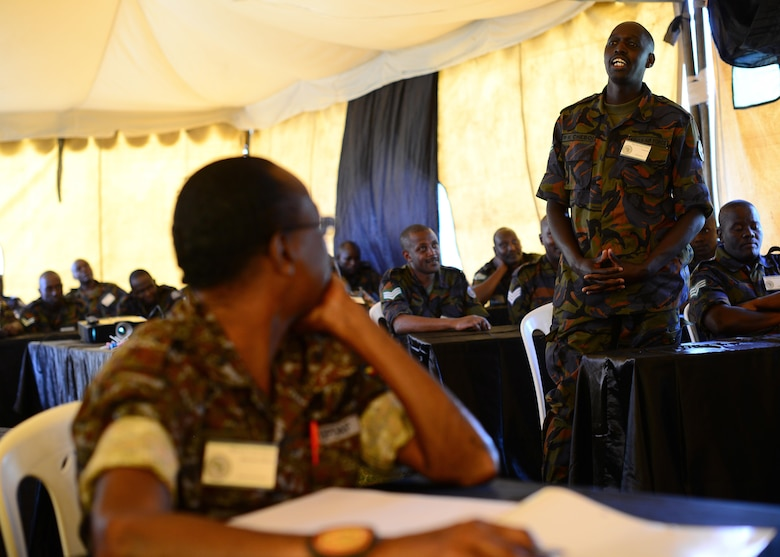 A Kenyan airman introduces himself during classroom training for African Partnership Flight Kenya at Laikipia Air Base, Kenya, June 20, 2016. More than 50 U.S. Air Force Airmen participated in the first African Partnership Flight in Kenya. The APF is designed for U.S. and African partner nations to work together in a learning environment to help build expertise and professional knowledge and skills. (U.S. Air Force photo by Tech. Sgt. Evelyn Chavez/Released)
