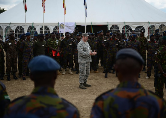 U.S. Air Force Maj. Todd Tyler, U.S. Air Forces in Europe and Air Forces Africa, African Partnership Flight Kenya mission commander, speaks with Kenyan and Ugandan Defense Forces at Laikipia Air Base, Kenya, June 20, 2016. More than 50 U.S. Air Force Airmen participated in the first African Partnership Flight in Kenya. The APF is designed for U.S. and African partner nations to work together in a learning environment to help build expertise and professional knowledge and skills. (U.S. Air Force photo by Tech. Sgt. Evelyn Chavez/Released)