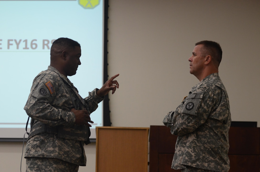 Lt. Col. Sean S. Brown (left), commander of the 724th Military Police Battalion, and Lt. Col. Robert Merry (right), the deputy commanding officer of 290th Military Police Brigade, both with the U.S. Army Reserve, talk before a briefing on exercise Guardian Justice at Fort McCoy, Wisc., June 20, 2016. Guardian Justice is a military police exercise that focuses on detention operations and combat support. (U.S. Army photo by Spc. Adam Parent)