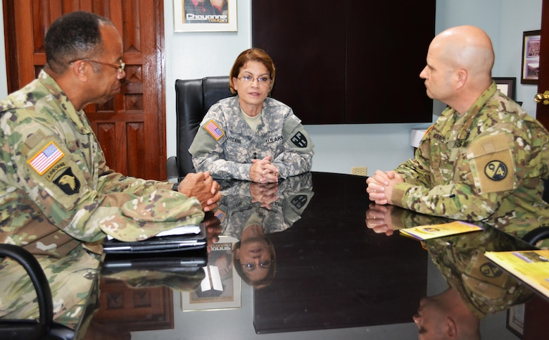 Maj. Gen. A.C. Roper, (L) commander of the 80th Training Command, Maj. Gen. Marta Carcana the adjutant general of the Puerto Rico National Guard, and Col. Albert Morris (L) commander, 5th Brigade 94th Training Division, discuss the ongoing relationship between the Puerto Rico National Guard and the brigade, which is subordinate to the 80th TC