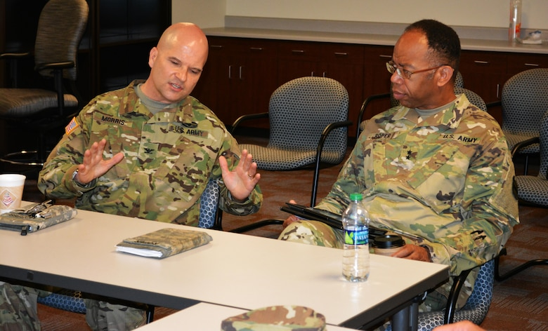 Col. Albert Morris, commander 5th Brigade 94th Training Division, discusses the state of the brigade with Maj. Gen. A.C. Roper, commander of the 80th Training Command, at Fort Allen, Puerto Rico, March 11, 2016. Fifth Brigade offers reclassification training in 10 Military Occupational Specialties and 12 Non-Commissioned Officer Education System courses, in compliance with U.S. Army Training and Doctrine Command accreditation standards. The multifunctional Army Reserve unit is also the only MOS qualification brigade in the Army Reserve that is 100 percent bilingual.