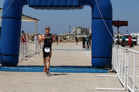 Navy Lt. Kyle Hooker of NAS Jacksonville, Fla. won his second straight Armed Forces individual gold medal and led Navy to team silver.  The 2016 Armed Forces Triathlon Championship was held at Naval Base Ventura County, Calif. on 18 June.