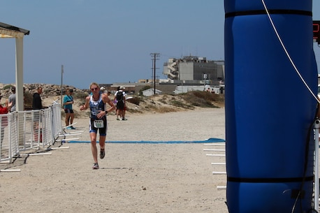 Air Force Maj Judith Coyle of Joint Base Lewis-McChord, Wash. captures the Armed Forces Women's Triathlon crown.  The 2016 Armed Forces Triathlon Championship was held at Naval Base Ventura County, Calif. on 18 June.