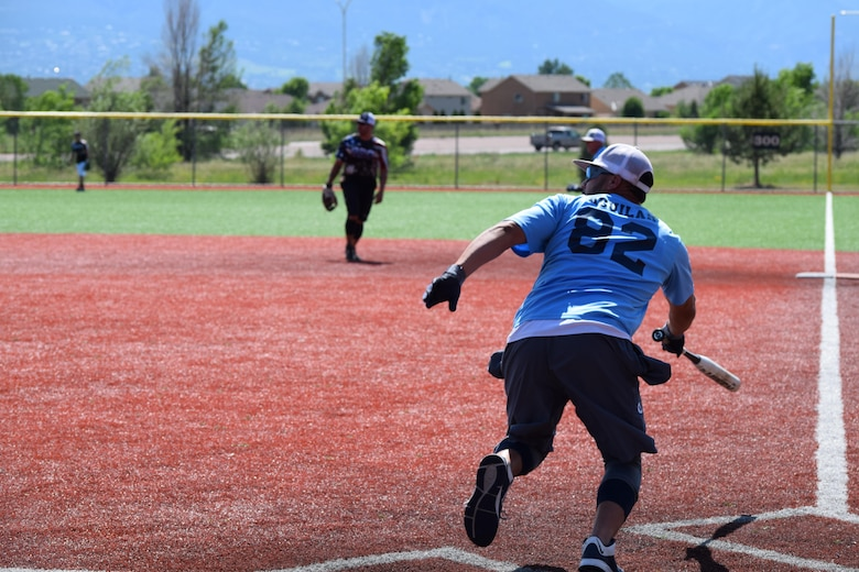 Miguel Aguilar, 82nd Force Support Squadron, hits a shot to the left side at a military softball tournament in Colorado, June 13, 2016. The Sheppard Senators, Sheppard Air Force Base's men's varsity softball team ranks first out of 57 Varsity 'A' military teams from around the country.