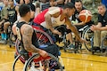 Marine Corps veteran Jorge Salazar tips his wheelchair while fighting for a ball during the basketball gold medal round of the 2016 Department of Defense Warrior Games at the U.S. Military Academy in West Point, N.Y., June 21, 2016. DoD photo by EJ Hersom