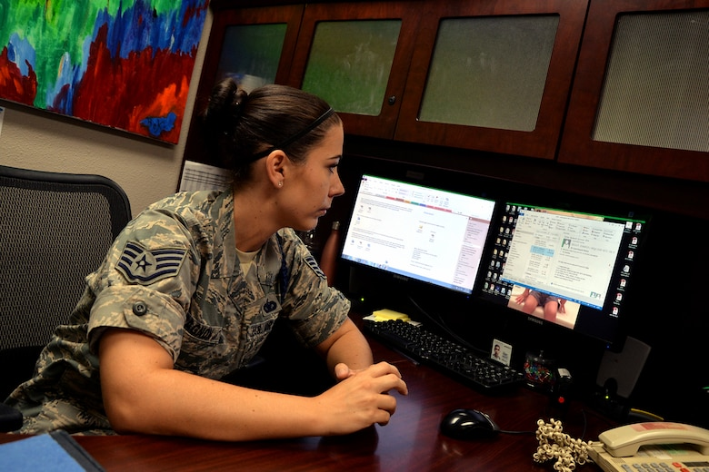U.S. Air Force Staff Sgt. Amber Gagnon, 316th Training Squadron military training leader, works at her computer on Goodfellow Air Force Base, Texas, June 17, 2016. The 316th TRS conducts Air Force, Army, Marine Corps, Navy and Coast Guard cryptologic, human intelligence and military training. (U.S. Air Force photo by Airman 1st Class Randall Moose/Released)