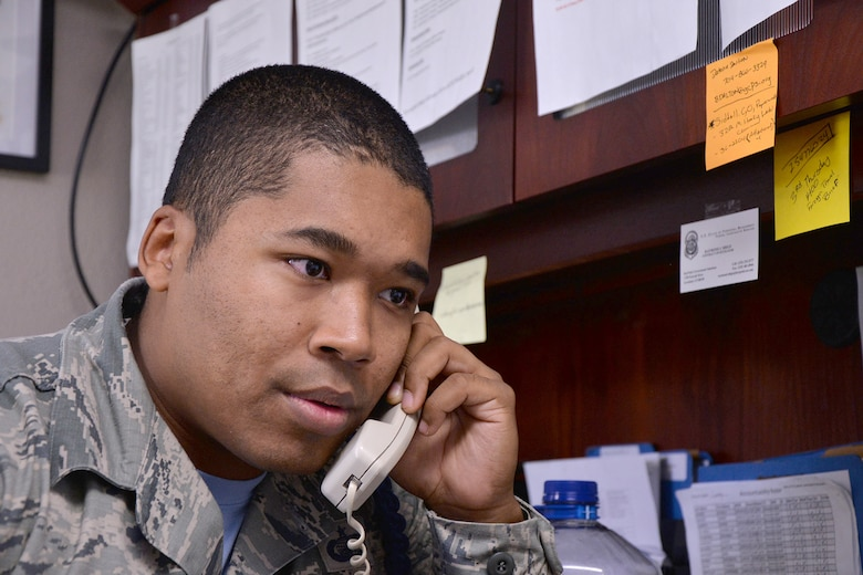 U.S. Air Force Tech. Sgt. Christopher Henry IV, 316th Training Squadron Military Training Leader, speaks on the phone on Goodfellow Air Force Base, Texas, June 17, 2016. MTLs are tasked to help students meet military regulations and pass their classes. (U.S. Air Force photo by Airman 1st Class Randall Moose/Released)