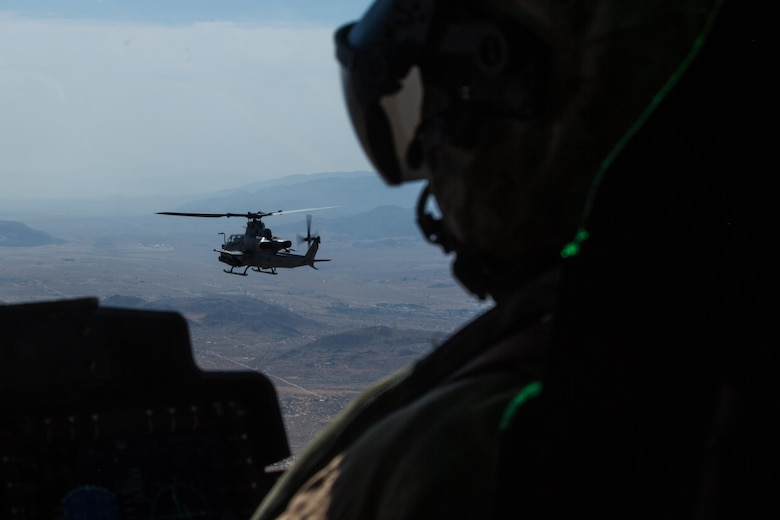 """An AH-1Z Viper with Marine Light Attack Helicopter Squadron (HMLA) 267 """"Stingers"""" flies as lead aircraft in a section flight to Marine Corps Air Ground Combat Center Twentynine Palms, Calif., June 10. Marines with HMLA-267 supported Marines with 3rd Battalion, 7th Marine Regiment, during a close-air-support training mission aboard the combat center. (U.S. Marine Corps photo by Sgt. Lillian Stephens/Released) (U.S. Marine Corps photo by Sgt. Lillian Stephens/Released)"""