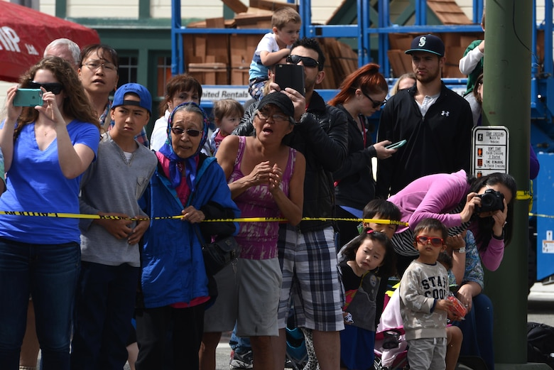 Onlookers take photos and watch the Hero Games during the Downtown Summer Solstice Festival in Anchorage, Alaska, June 18, 2016. Anchorage's Town Square was surrounded by numerous events and vendors for people to enjoy, including the Hero Games, a friendly competition between Alaska's first responders with challenges that require balance, strength and teamwork. (U.S. Air Force photo Airman 1st Class Christopher R. Morales)