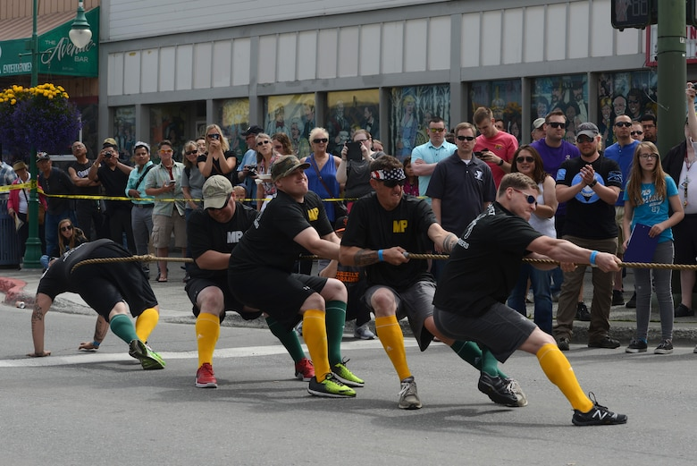 The 'Arctic Defenders,' of the 545th Military Police Company, competes in a tug-of-war challenge as part of the Hero Games during the Downtown Summer Solstice Festival in Anchorage, Alaska, June 18, 2016. Tug-of-war was the semi-final challenge to determine the final two teams. The Hero Games is a friendly competition between Alaska's first responders with challenges that require balance, strength and teamwork. (U.S. Air Force photo Airman 1st Class Christopher R. Morales)
