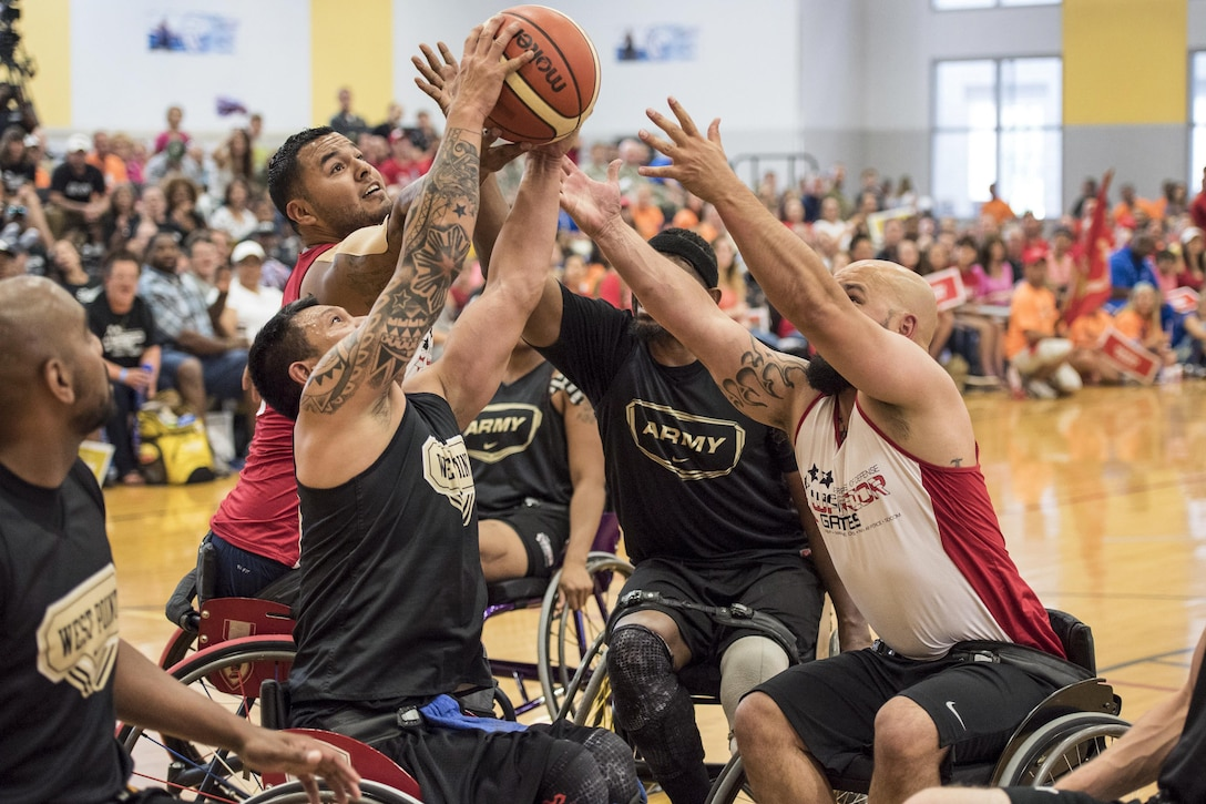 Left to right: Army veteran Delvin Matson, Army veteran Jhoonar Barrera, Marine Corps veteran Jorge Salazar, Army veteran Alexander Shaw and Marine Corps veteran Jeremy Lake grab for the ball as soldiers defeat Marines to win gold in wheelchair basketball during the 2016 Department of Defense Warrior Games at the U.S. Military Academy in West Point, N.Y., June 21, 2016. DoD photo by Roger Wollenberg