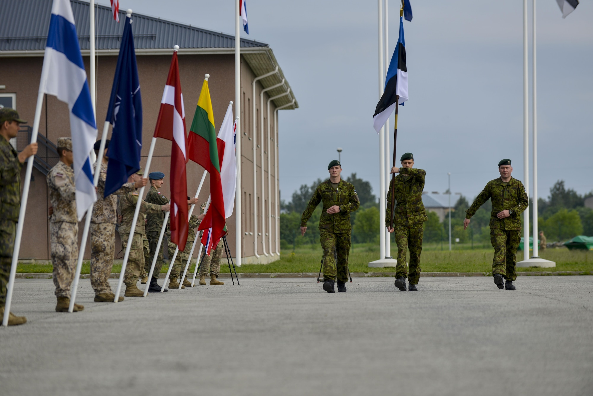 Estonian soldiers present the colors during the closing ceremony for Saber Strike 16 at Tapa Training Base, Estonia, June 21, 2016. U.S. forces in Europe participated in Saber Strike 16; a long-standing, U.S. Joint Chiefs of Staff-directed, U.S. Army Europe-led cooperative-training exercise, which has been conducted annually since 2010.  This year's exercise focused on promoting interoperability with allies and regional partners. The United States has enduring interests in supporting peace and prosperity in Europe and bolstering the strength and vitality of NATO, which is critical to global security. (U.S. Air Force photo/Senior Airman Nicole Keim)
