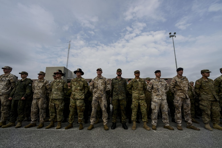 NATO service members stand in formation during a closing ceremony at Tapa Training Base, Estonia, June 21, 2016. U.S. forces in Europe participated in Saber Strike 16; a long-standing, U.S. Joint Chiefs of Staff-directed, U.S. Army Europe-led cooperative-training exercise, which has been conducted annually since 2010. This year's exercise focused on promoting interoperability with allies and regional partners. The United States has enduring interests in supporting peace and prosperity in Europe and bolstering the strength and vitality of NATO, which is critical to global security. (U.S. Air Force photo/Senior Airman Nicole Keim)
