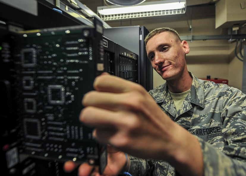 Airman 1st Class Patrick Nunn, an airfield systems technician with the 1st Special Operations Support Squadron, pulls a circuit board for inspection at Hurlburt Field, Fla., June 17, 2016. Airfield systems technicians install, remove and maintain navigation and air traffic control ground-to-air radio systems. (U.S. Air Force photo by Airman 1st Class Joseph Pick)