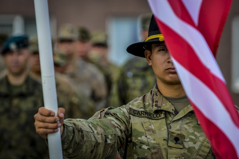 A U.S. Army Soldier holds the U.S. flag during a closing ceremony at Tapa Training Base, Estonia, June 21, 2016. U.S. forces in Europe participated in Saber Strike 16; a long-standing, U.S. Joint Chiefs of Staff-directed, U.S. Army Europe-led cooperative-training exercise, which has been conducted annually since 2010. This year's exercise focused on promoting interoperability with allies and regional partners. The United States has enduring interests in supporting peace and prosperity in Europe and bolstering the strength and vitality of NATO, which is critical to global security. (U.S. Air Force photo/Senior Airman Nicole Keim)