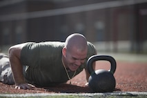 A Marine from Alpha Co., Marine Barracks Washington, D.C., conducts burpees during the high intensity tactical training, Tactical Athlete Competition at the Annex Field, June 22, 2016. The competition illustrates the advanced dynamics of the HITT training program and recognizes Marines that encompass all facets of a tactical athlete. Today's winners, Gunnery Sgt. Zoraida Rodriguez-Keeton, United States Marine Band, and Cpl. Christopher Weddington, A Co., will represent the Barracks during the Marine Corps-wide HITT Competition taking place at MCAS Miramar in August. (Official Marine Corps photo by Cpl. Chi Nguyen/Released)