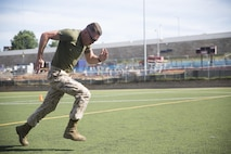 A Marine from the United States Drum and Bugle Corps, Marine Barracks Washington, D.C., conducts a 25-yard dash during the high intensity tactical training, Tactical Athlete Competition at the Annex Field, June 22, 2016. The competition illustrates the advanced dynamics of the HITT training program and recognizes Marines that encompass all facets of a tactical athlete. Today's winners, Gunnery Sgt. Zoraida Rodriguez-Keeton, United States Marine Band, and Cpl. Christopher Weddington, A Co., will represent the Barracks during the Marine Corps-wide HITT Competition taking place at MCAS Miramar in August. (Official Marine Corps photo by Cpl. Chi Nguyen/Released)