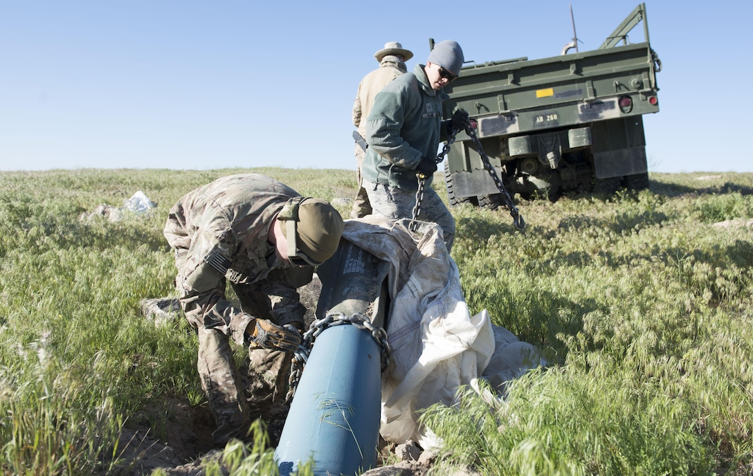 Explosive ordnance disposal members from the 366th Civil Engineer Squadron prepare for an inert GBU-12 Paveway II extraction during a range clearance at Saylor Creek Range Complex, Idaho, May 9, 2016. The training range's impact areas consist of approximately 24,000 acres of exclusive use area land. The ranges provide aircrews a realistic layout of simulated targets similar to those they might encounter during actual combat, such as an airfield, an industrial complex and radar, missile, gun and artillery sites. (U.S. Air Force photo by Airman 1st Class Chester Mientkiewicz/Released)