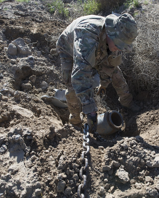 An explosive ordnance disposal member from the 366th Civil Engineer Squadron prepares an inert GBU-12 Paveway II for extraction during a range clearance at Saylor Creek Range Complex, Idaho, May 9, 2016. There are approximately 97,000 acres of Air Force owned, joint-use land around Saylor Creek Range where public access is permitted. (U.S. Air Force photo by Airman 1st Class Chester Mientkiewicz/Released)