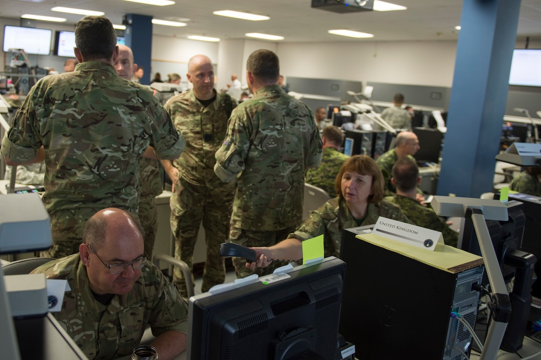 """Participants at the Cyber Guard 2016 exercise work through a June 16. 2016, training scenario during the nine-day exercise in Suffolk, Va., that concluded last week. Air Force Lt. Gen. James K. """"Kevin"""" McLaughlin, the deputy commander of U.S. Cyber Command, told the House Armed Services Committee June 22 that the exercise is critical to training cyber warriors to operate in the new domain. DoD photo by Navy Petty Officer 2nd Class Jesse A. Hyatt"""