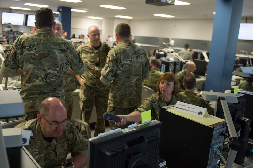 "Participants at the Cyber Guard 2016 exercise work through a June 16. 2016, training scenario during the nine-day exercise in Suffolk, Va., that concluded last week. Air Force Lt. Gen. James K. ""Kevin"" McLaughlin, the deputy commander of U.S. Cyber Command, told the House Armed Services Committee June 22 that the exercise is critical to training cyber warriors to operate in the new domain. DoD photo by Navy Petty Officer 2nd Class Jesse A. Hyatt"