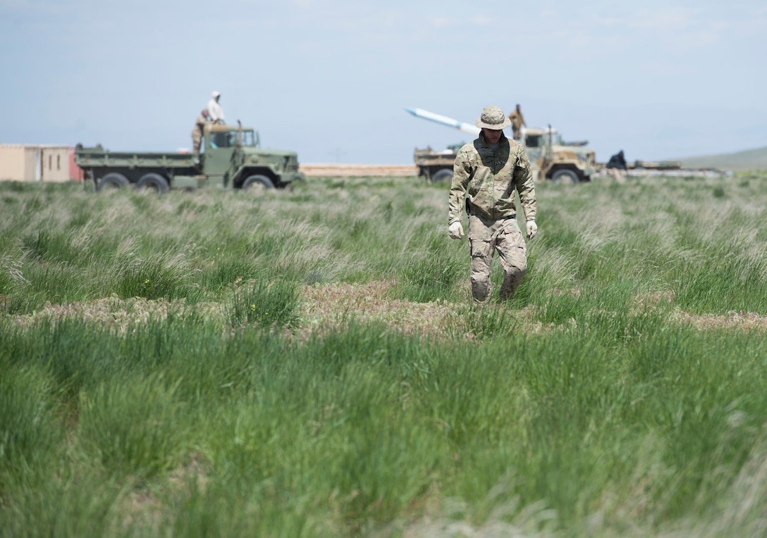 Explosive ordnance disposal members from the 366th Civil Engineer Squadron scan the range for explosives during a range clearance at Saylor Creek Range Complex, Idaho, May 9, 2016. The most common explosives found during the clearance were simulated surface-to-air missiles, called Smokey SAMs. (U.S. Air Force photo by Airman 1st Class Chester Mientkiewicz/Released)