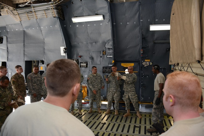 Soldiers from the 1397 Deployment and Distribution Support Battalion receive training from Air Force Reserve aerial porters June 18, 2016, on how to properly secure vehicles on the C-5 Galaxy.  (U.S. Air Force photos/Staff Sgt. Madelyn Brown)