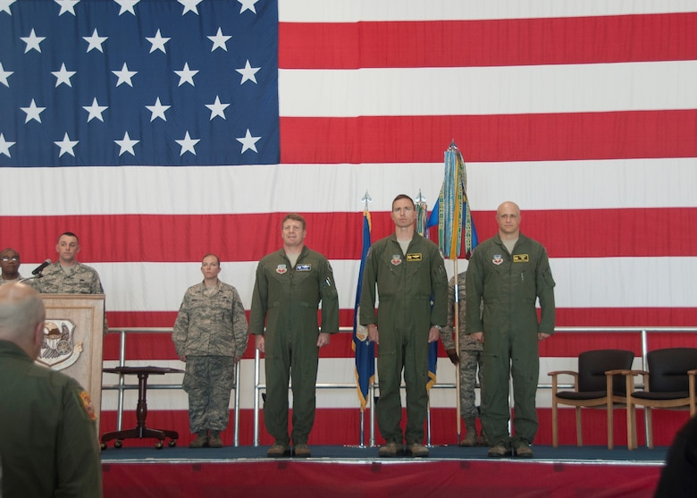 Col. James McCune, 495th Fighter Group commander, left, Lt. Col. John Galloway, Jr., 358th Fighter Squadron outgoing commander, and Maj. Jeremiah Parvin, 358th Fighter Squadron new commander, stand at attention during the change of command ceremony in the A-10 hangar at Whiteman Air Force Base, June 21, 2016. Nearly 100 Airmen, from maintainers to pilots, train and support the 358 FS, an active duty component attached to the 442d Fighter Wing. (U.S. Air Force photo by Senior Airman Missy Sterling/Released)