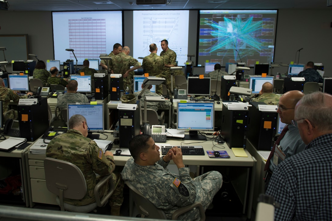 Participants at Cyber Guard 2016 work through a June 16, 2016, training scenario during the nine-day exercise in Suffolk, Va. Air Force Brig. Gen. Charles Moore, the Joint Staff's deputy director of global operations, told Congress June 22 that Cyber Guard and exercises like it test the abilities of Cyber Mission Force teams to defend Defense Department networks. DoD photo by Navy Petty Officer 2nd Class Jesse A. Hyatt