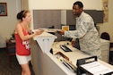 Staff Sgt. Wesley Ramsey, 2nd Logistics Readiness Squadron personal property counselor, goes over the process of moving household goods for a retired member at the Traffic Management Office on Barksdale Air Force Base, La., June 17, 2016. Ramsey ensured all information was correct on her DD Form 2278 to assist with the move of her property. (U.S. Air Force photo/Airman Alexis Frost)